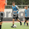 Rob Winner – rwinner@shawmedia.com<br /> <br /> James Stevenson (center), a senior from Scotland, participates in a drill during a Northern Illinois University soccer practice in DeKalb Wednesday, Aug. 28, 2013.