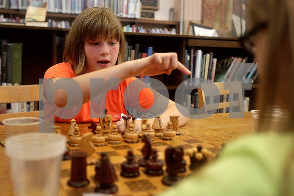 Monica Maschak - mmaschak@shawmedia.com<br /> Olivia Rohlman, 9, contemplates her next chess move during a Harry Potter party at the DeKalb Library on Tuesday, August 27, 2013. The party was to celebrate the 15th anniversary of the Harry Potter books.