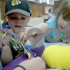 Monica Maschak - mmaschak@shawmedia.com<br /> Shelby Johnsen (right), 3, helps her brother, Vincent Johnsen, 2, make a golden snitch during a Harry Potter party at the DeKalb Library on Tuesday, August 27, 2013. The party was to celebrate the 15th anniversary of the Harry Potter books.