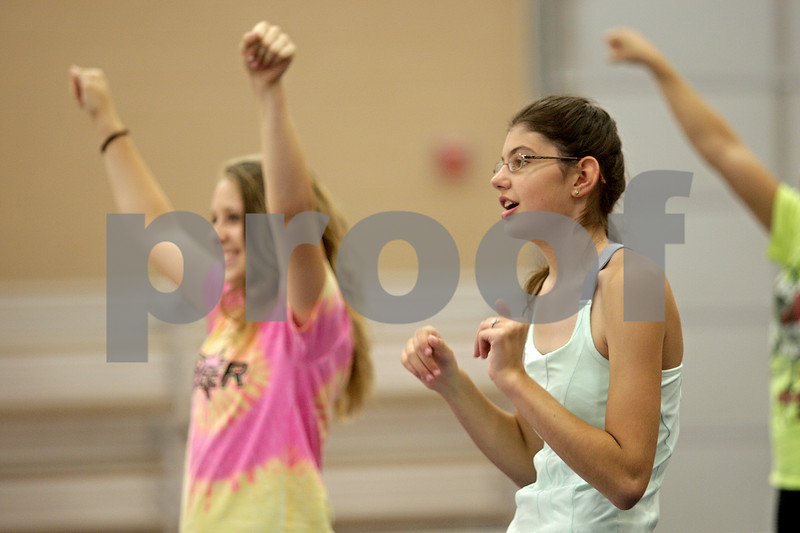 Monica Maschak - mmaschak@shawmedia.com<br /> Freshman Rebecca Butler runs through a new cheer with the DeKalb Sparkles during a cheer practice at DeKalb High School on Wednesday, August 21, 2013. The Sparkles is an inclusive team bringing special needs students, like Butler, together with her cheerleading peers. The school partners with a nonprofit group called Sparkle Effect that supports these kinds of teams across the country.