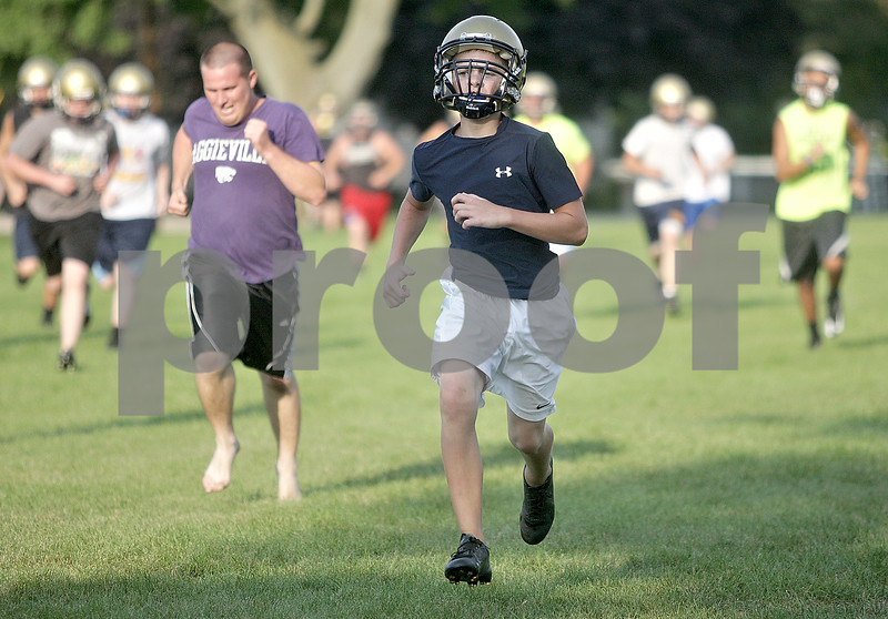 Monica Maschak - mmaschak@shawmedia.com<br /> Hiawatha Freshman cornerback and wide receiver Eric Letterer leads his teammates in running during a conditioning after practice on Thursday, August 15, 2013.