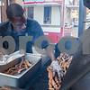 Erik Anderson - For the Daily Chronicle<br /> Dwight Bomar of Countrystore & Catering puts rib tips on the grill during the start of the block party at the intersection of Somonauk Street and Elm Street in downtown Sycamore on Saturday, August 24, 2013.