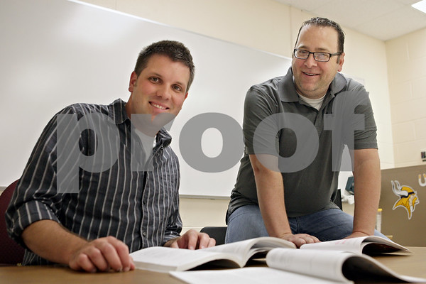 Rob Winner – rwinner@shawmedia.com<br /> <br /> Ben Doty (left), former Sycamore High School student and now English teacher, works alongside his former instructor Rich Majerus at SHS. Doty graduated from SHS in 2001 and is beginning his fifth year as an English teacher. Majerus has been teaching at the school for 18 years.<br /> <br /> Thursday, Aug. 8, 2013<br /> Sycamore, Ill.