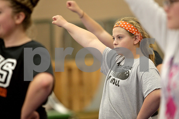 Monica Maschak - mmaschak@shawmedia.com<br /> Junior Edith Reynolds runs through a new cheer with the DeKalb Sparkles during a cheer practice at DeKalb High School on Wednesday, August 21, 2013. The Sparkles is an inclusive team bringing special needs students, like Reynolds, together with her cheerleading peers. The school partners with a nonprofit group called Sparkle Effect that supports these kinds of teams across the country.