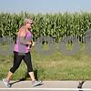 Monica Maschak - mmaschak@shawmedia.com<br /> Nanci Holtsford, from Texas, runs beside the corn fields at the annual Corn Classic 3 km and 10 km races on Saturday, August 24, 2013.