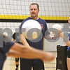 Monica Maschak - mmaschak@shawmedia.com<br /> Sycamore Varsity Volleyball Coach Eric Nore tosses balls to players at practice on Tuesday, August 20, 2013.