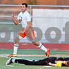 Monica Maschak - mmaschak@shawmedia.com<br /> Forward Dylan Hottsmith raises his finger after scoring a goal in the second half of a Barb Cup match against Burlington at DeKalb High School on Wednesday, August 28, 2013. The Barbs won 4-1.