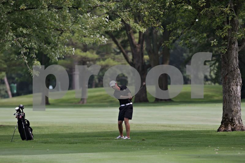Rob Winner – rwinner@shawmedia.com<br /> <br /> Sycamore's Ryan Aurand takes his second stroke on the first hole at Kishwaukee Country Club in DeKalb on Monday, Aug. 26, 2013.