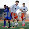 Monica Maschak - mmaschak@shawmedia.com<br /> Brandon Canaday (18) holds his ground during a Barb Cup match against Burlington at DeKalb High School on Wednesday, August 28, 2013. The Barbs won 4-1.