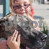 Erik Anderson - For the Daily Chronicle<br /> Sara Aslakson, 9, of Sycamore holds Zues, a breed of Great Dane during during the block party at the intersection of Somonauk Street and Elm Street in downtown Sycamore on Saturday, August 24, 2013.