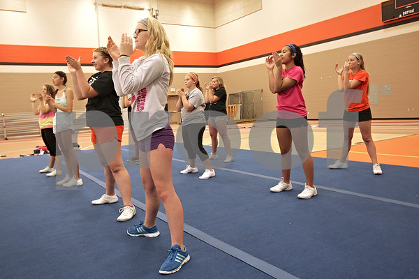 Monica Maschak - mmaschak@shawmedia.com<br /> The DeKalb Sparkles go through cheers during a cheer practice at DeKalb High School on Wednesday, August 21, 2013. The Sparkles is an inclusive team bringing special needs students together with their cheerleading peers. The school partners with a nonprofit group called Sparkle Effect that supports these kinds of teams across the country.