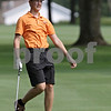 Rob Winner – rwinner@shawmedia.com<br /> <br /> DeKalb's Jacob Cook follows his ball after his second stroke on the first hole at Kishwaukee Country Club in DeKalb on Monday, Aug. 26, 2013.