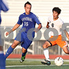 Monica Maschak - mmaschak@shawmedia.com<br /> Midfielder Gerardo Dorantes looks to pass before the ball gets stolen during a Barb Cup match against Burlington at DeKalb High School on Wednesday, August 28, 2013. The Barbs won 4-1.