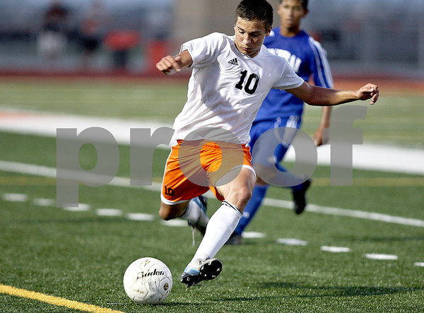 Monica Maschak - mmaschak@shawmedia.com<br /> Midfielder Sean Woodford rushes to keep the ball inbounds during a Barb Cup match against Burlington at DeKalb High School on Wednesday, August 28, 2013. The Barbs won 4-1.