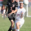 Monica Maschak - mmaschak@shawmedia.com<br /> Jake Dodd (7) and Tommy Hansen (24) watch the ball in the aftermath of colliding in the first half of a match at Genoa-Kingston High School on Thursday, September 5, 2013. The Cogs shut out the Timberwolves 6-0.