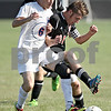 Monica Maschak - mmaschak@shawmedia.com<br /> Juan Da Silva, of Genoa-Kingston, steals the ball from Indian Creek's Gavin Eberly in the first half of a match at Genoa-Kingston High School on Thursday, September 5, 2013. The Cogs shut out the Timberwolves 6-0.