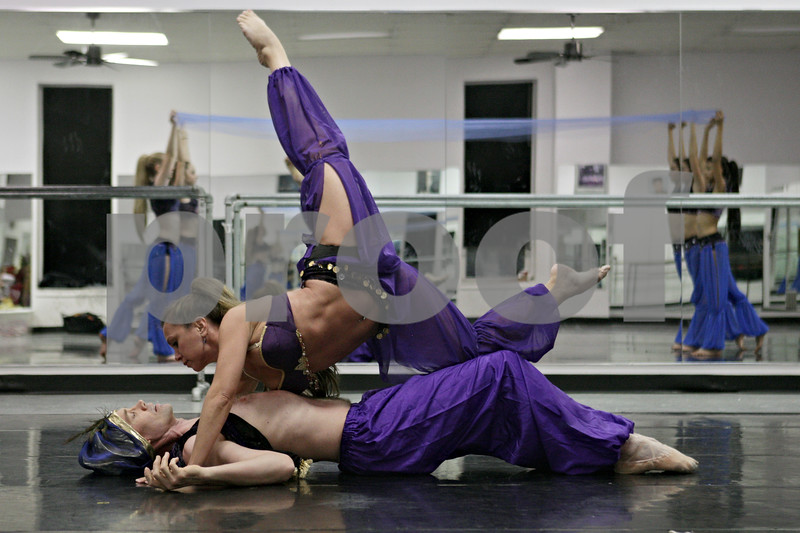 Rob Winner – rwinner@shawmedia.com<br /> <br /> Beth Fowler (top) and Larry Pool practice a dance during a rehearsal for the Nutcracker at the Beth Fowler School of Dance in Genoa on Monday, Dec. 2, 2013.