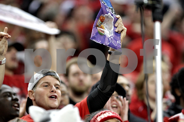 Monica Maschak - mmaschak@shawmedia.com<br /> A Northern Illinois fan shows off a Tostitos Chips bag in hopes of the team going to the Tostitos Bowl at Ford Field on Friday, December 6, 2013.