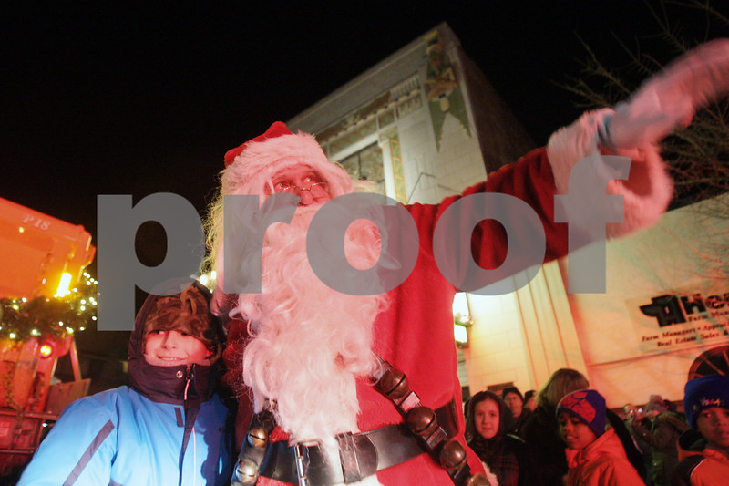 Rob Winner – rwinner@shawmedia.com<br /> <br /> Cole Anderson, 8, of DeKalb greets Santa Claus outside the Egyptian Theatre in downtown DeKalb, Ill., Thursday, Dec. 5, 2013.