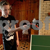 Monica Maschak - mmaschak@shawmedia.com<br /> Brandon Nikkila, 12, plays ping pong at his family's home in Sycamore on Saturday, November 23, 2013. Nikkila is on the waiting list for a Big Brother match-up.