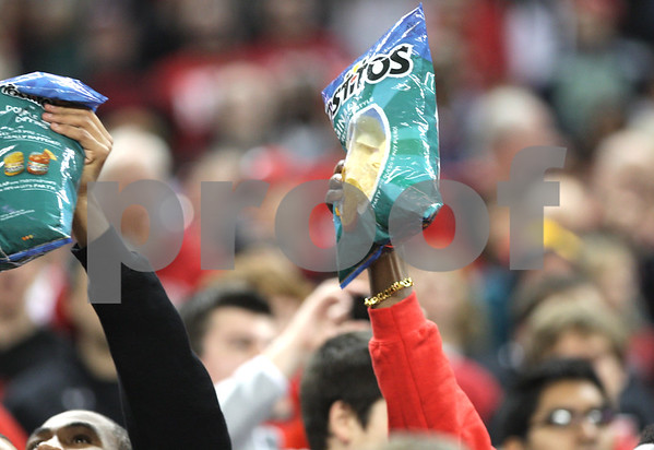 Monica Maschak - mmaschak@shawmedia.com<br /> Norther Illinois fans show off Tostitos Chips bags at Ford Field on Friday, December 6, 2013.