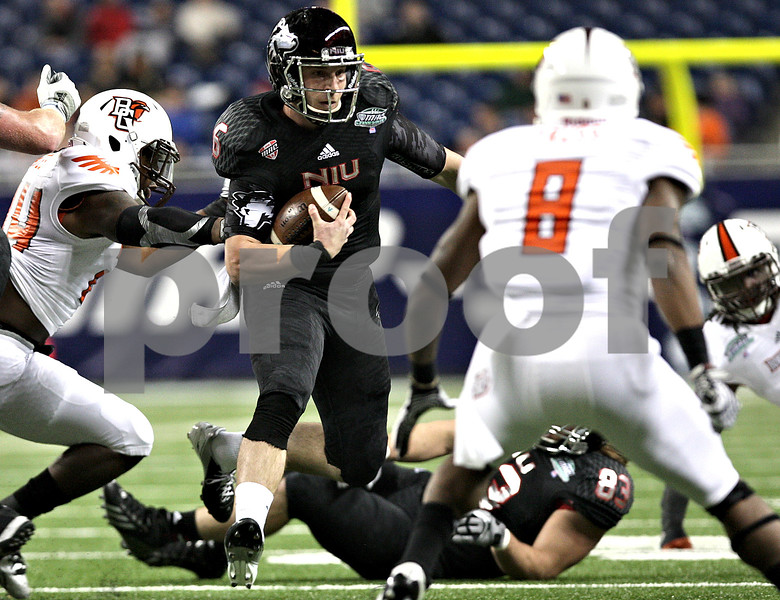 Monica Maschak - mmaschak@shawmedia.com<br /> Quarterback Jordan Lynch carries the ball in the first quarter of the MAC Championship game against Bowling Green at Ford Field on Friday, December 6, 2013. The Huskies are down, 31-13, at the half.