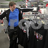 Rob Winner – rwinner@shawmedia.com<br /> <br /> Northern Illinois University alumnus Chris Akers of Chicago tries on a sweatshirt while shopping for NIU Huskie gear at the Village Commons Bookstore in DeKalb on Tuesday, Dec. 3, 2013. Akers had just picked up his tickets for the Mid-American Conference championship game when he decided to stop by the bookstore to look for some fan apparel.