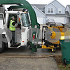 Rob Winner – rwinner@shawmedia.com<br /> <br /> Daniel Mueller of Waste Management uses his truck to collect recyclable waste on Williams Way within the Eden's Garden subdivision in DeKalb on Wednesday, Dec. 4, 2013.