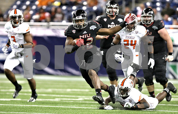 Monica Maschak - mmaschak@shawmedia.com<br /> Running back Cameron Stingily leaves a tackle in the dust in the third quarter of the MAC Championship game against Bowling Green at Ford Field on Friday, December 6, 2013. The Huskies ended their perfect season with a, 27-47, loss to the Falcons.