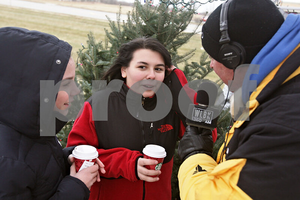 Rob Winner – rwinner@shawmedia.com<br /> <br /> Katrina LeMieux (left), 13, and Ahna Silva, 13, of Clinton Rosette Middle School are interviewed by 1360 WLBK host Terry 'TD' Ryan live on-the-air during the Freezin' for Food 13th annual food drive in DeKalb on Thursday afternoon. Students at Clinton Rosette collected nearly 600 pounds of food for the drive.