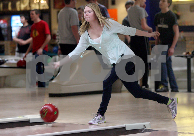 Monica Maschak - mmaschak@shawmedia.com<br /> Sophomore Kelly Drake launches the ball down the lane during bowling practice at Four Seasons Sports in Sycamore on Tuesday, December 3, 2013.