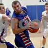Monica Maschak - mmaschak@shawmedia.com<br /> Connor Bankson twists away from his opponents in the third quarter against Hinckley-Big Rock in Hinckley on Tuesday, December 3, 2013. The Cogs beat the Royals, 60-45.