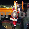Rob Winner – rwinner@shawmedia.com<br /> <br /> Santa Claus waves to the crowd outside the Egyptian Theatre after arriving in a snow plow truck in downtown DeKalb, Ill., Thursday, Dec. 5, 2013.