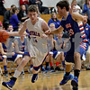 Monica Maschak - mmaschak@shawmedia.com<br /> Chris Taylor pushes his way to the hoop in the first quarter against Genoa-Kingston on Tuesday, December 3, 2013. The Royals lost to the Cogs, 60-45.