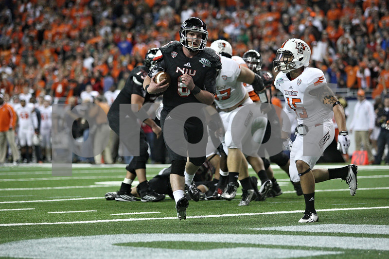 Monica Maschak - mmaschak@shawmedia.com<br /> Running back James Spencer leans over for a first down in the fourth quarter of the MAC Championship game against Bowling Green at Ford Field on Friday, December 6, 2013. The Huskies ended their perfect season with a, 27-47, loss to the Falcons.