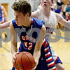 Monica Maschak - mmaschak@shawmedia.com<br /> Tommy Hansen tries to stay inbounds in the third quarter against Hinckley-Big Rock in Hinckley on Tuesday, December 3, 2013. The Cogs beat the Royals, 60-45.