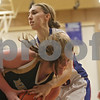 Rob Winner – rwinner@shawmedia.com<br /> <br /> Marquette's Cassidy Murphy (front) controls a rebound ahead of Hinckley-Big Rock's Karrigan Cowan (33) during the second quarter in Hinckley on Monday, December 2, 2013.