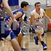 Monica Maschak - mmaschak@shawmedia.com<br /> Jacob Ryan dribbles into the zone in the first quarter against Genoa-Kingston on Tuesday, December 3, 2013. The Royals lost to the Cogs, 60-45.