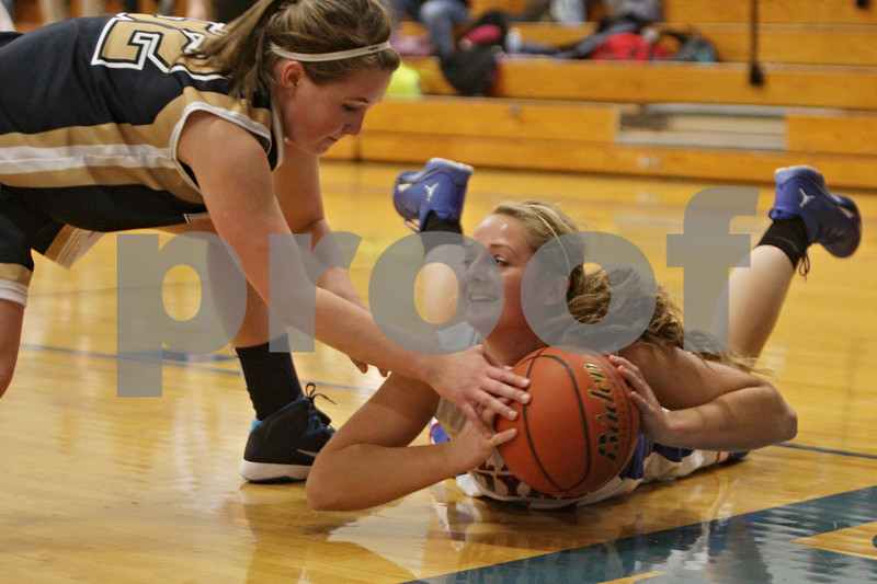 Rob Winner – rwinner@shawmedia.com<br /> <br /> Marquette's Kendall Kaufmann (left) reaches for a ball controlled by Hinckley-Big Rock's Lauren Paver (right) during the first quarter in Hinckley on Monday, December 2, 2013.