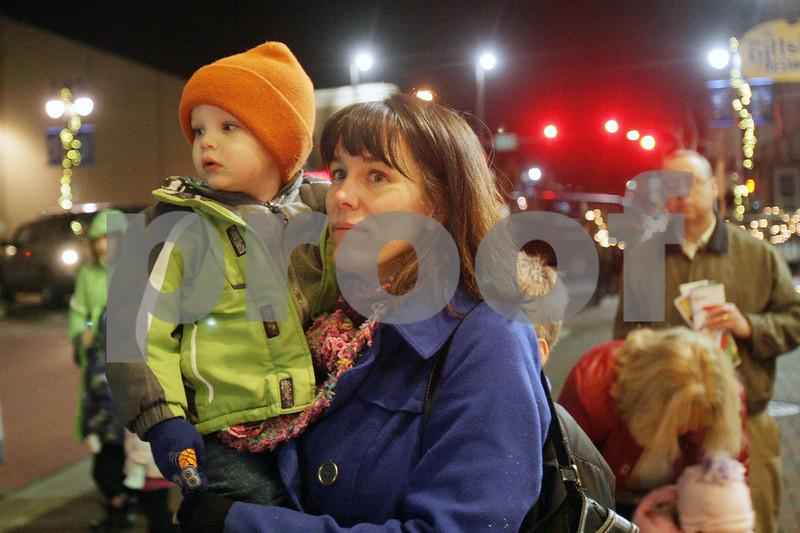 Rob Winner – rwinner@shawmedia.com<br /> <br /> Jack Gannon, 3, and his mother Katherine Gannon of DeKalb await the arrival of Santa Claus outside the Egyptian Theatre on Thursday, Dec. 5, 2013.