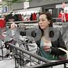Rob Winner – rwinner@shawmedia.com<br /> <br /> Northern Illinois University nursing student Claire Desrosiers looks over some NIU T-shirts at the Village Commons Bookstore in DeKalb on Tuesday, Dec. 3, 2013.