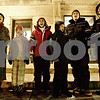 Monica Maschak - mmaschak@shawmedia.com<br /> The Webster family, with the Kishwaukee Bible Church, carol Christmas songs during a luminaria vigil, to commemorate and remember those who have lost the fight in the battle of cancer or who are currently fighting, in front of the DeKalb County Courthouse on Thursday, December 12, 2013.