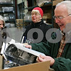 "Rob Winner – rwinner@shawmedia.com<br /> <br /> (From right to left) Authors of ""Acres of Change"" including Terry Martin, Sherrie Martin and Sue Breese react while looking through the book for the first time after it arrived at Blackhawk Moving and Storage in Sycamore, Ill., Thursday, Dec. 12, 2013. The Martins, who are married,  wrote the education chapter and Breese is the co-author of the agriculture chapter."