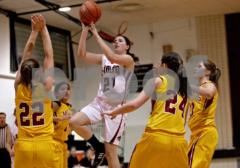 Monica Maschak - mmaschak@shawmedia.com<br /> Alexis Van Wyhe attempts two points in the second quarter against Morris at Indian Creek High School on Tuesday, December 10, 2013. The Timberwolves lost, 68-47.