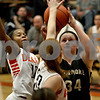 Monica Maschak - mmaschak@shawmedia.com<br /> Kayley Aase aims for the hoop in the second quarter on Friday, December 13, 2013. The Spartans beat the Barbs 32-29.