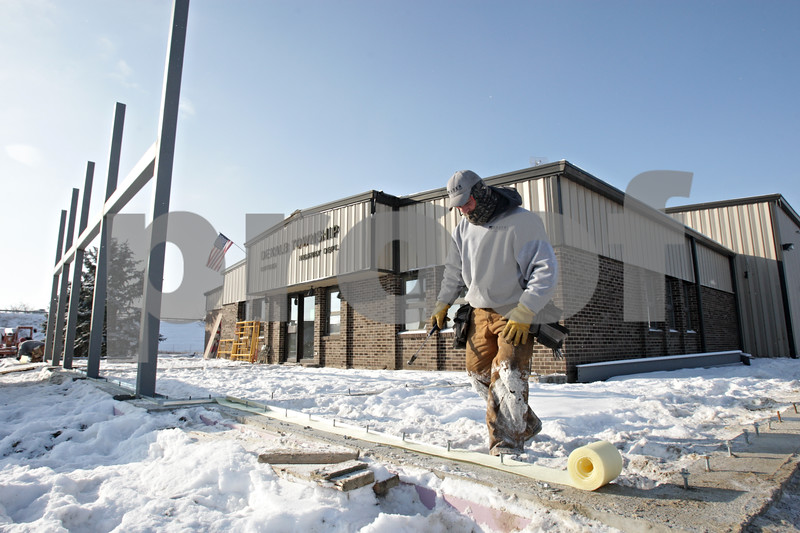 Rob Winner – rwinner@shawmedia.com<br /> <br /> Joe Huenefeld of Freeport works on construction of a new wall outside the DeKalb Township building located on South Fourth Street in DeKalb, Ill., Wednesday, Dec. 11, 2013.
