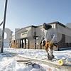 Rob Winner – rwinner@shawmedia.com<br /> <br /> Joe Huenefeld of Freeport works on construction of a new wall outside the DeKalb Township building located on South Fourth Street in DeKalb, Ill., Wednesday, Dec. 11, 2013.