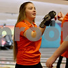 Monica Maschak - mmaschak@shawmedia.com<br /> DeKalb's Maddy Jouris fist bumps a teammate after her turn at a bowling match between DeKalb and Sycamore at Mardi Gras Lanes on Thursday, December 12, 2013.