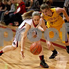 Monica Maschak - mmaschak@shawmedia.com<br /> Madison Russell grabs a loose ball in the first quarter against Morris at Indian Creek High School on Tuesday, December 10, 2013. The Timberwolves lost, 68-47.