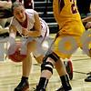 Monica Maschak - mmaschak@shawmedia.com<br /> Rebekka Boekne passes under the hoop in the first quarter against Morris at Indian Creek High School on Tuesday, December 10, 2013. The Timberwolves lost, 68-47.